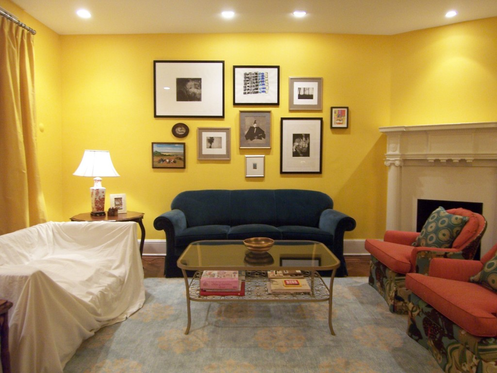 Yellow living room benjamin moore s 343 sunrays and a new art wall bossy color annie elliott - How to decorate living room walls ...