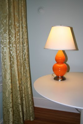 Orange lamp with green drapes