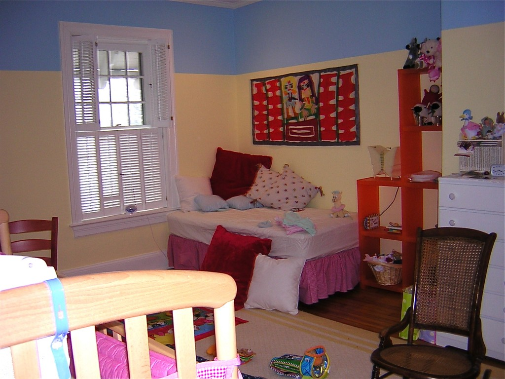 Shutters in yellow bedroom