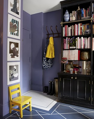 Purple foyer with black built-in shelving