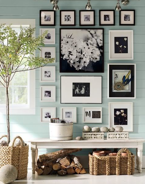Light blue-gray foyer with photographs