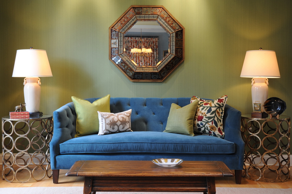Living room with blue velvet sofa and green Farrow & Ball dragged wallpaper