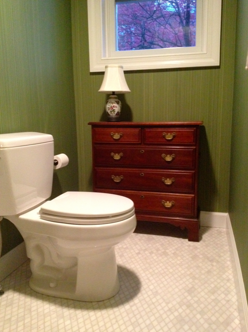 Powder room with bachelor's chest and Farrow & Ball wallpaper