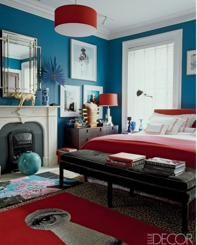 Blue bedroom with red bedspread Elle Decor
