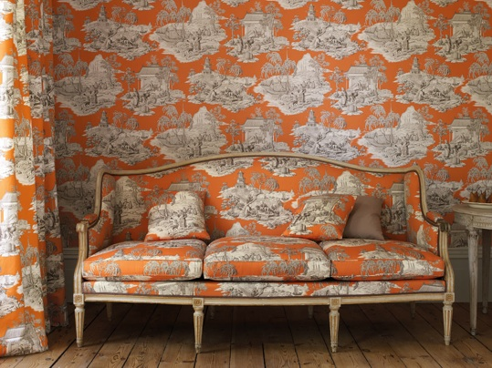 Manuel Canovas orange toile fabric and wallcovering
