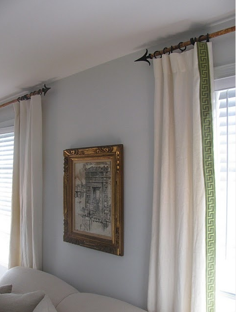 Drapes with trim on leading edge