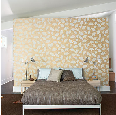 Metallic wallpaper accent wall behind bed as headboard