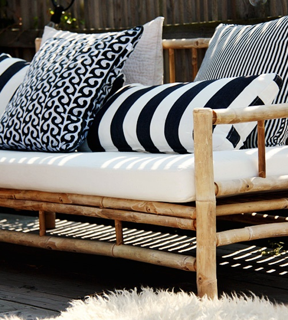 Large black and white accent pillows on outdoor furniture