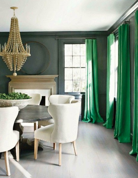 Green drapes in gray dining room