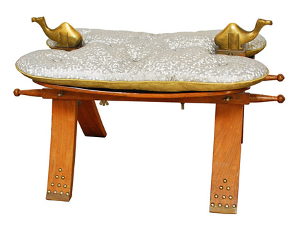 Low stool with wooden legs and cushion