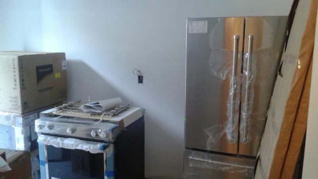 Refrigerator and stove in unrenovated DC kitchen