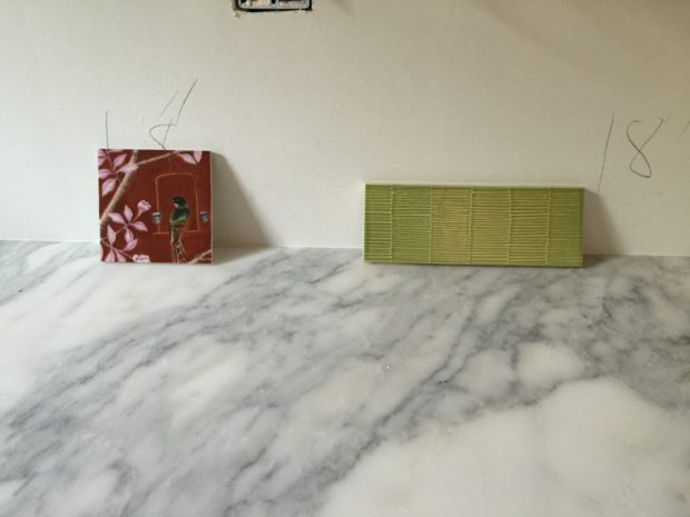 Red tile sample, green tile, marble kitchen counter