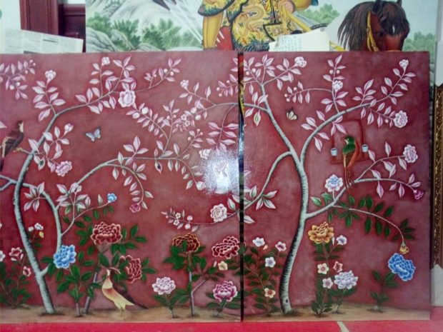 Painted red painting of birds, leaves, trees for kitchen backsplash