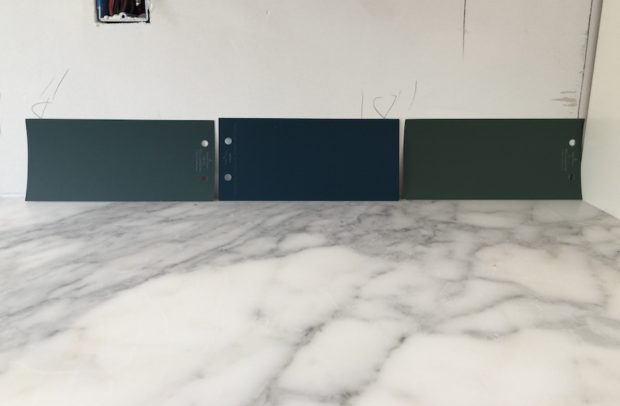 Blue paint swatches on marble kitchen counter