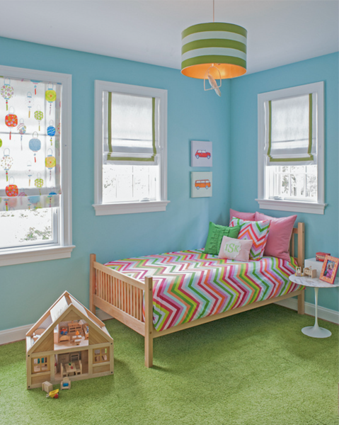 Light blue girl's bedroom with striped bedding and Roman shades and dollhouse