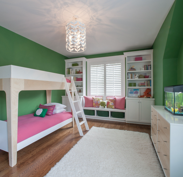 Grass green bedroom with bunk beds and built-in shelving