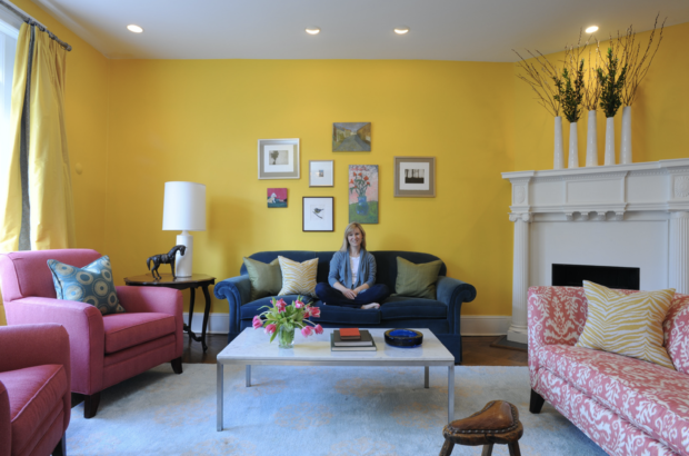 Yellow living room with blue sofa