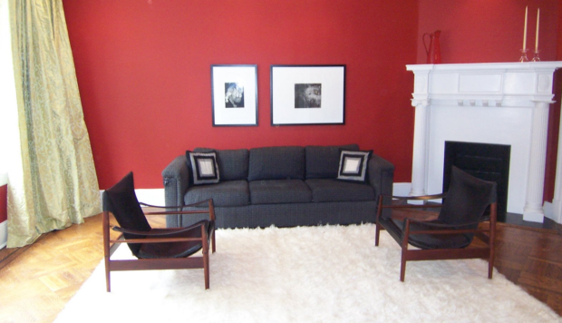 Red living room with black mid-century chairs