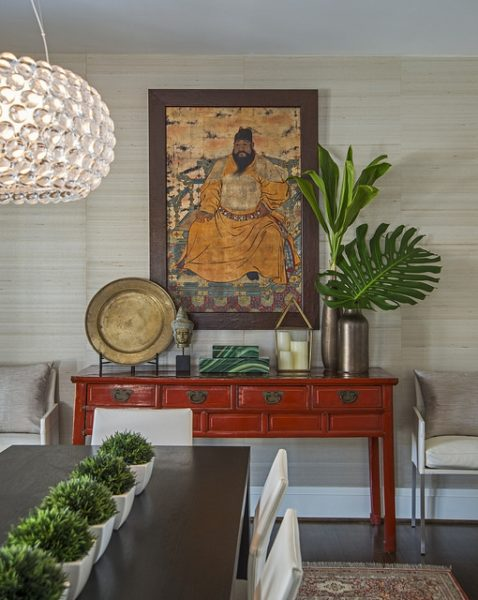 Asian-inspired dining room with red table and chinese artwork, Caboche light fixture