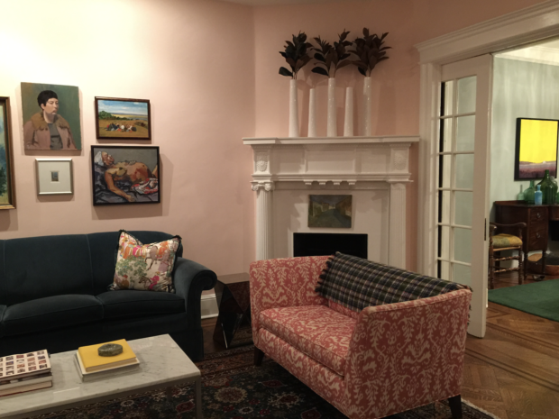 Pink living room with pink and white settee and fireplace