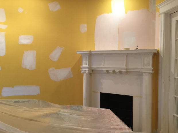 Yellow room with white fireplace