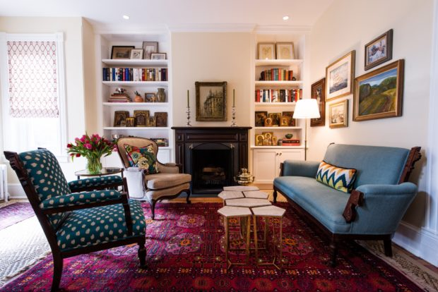 Living room with bookcases and Oriental rug