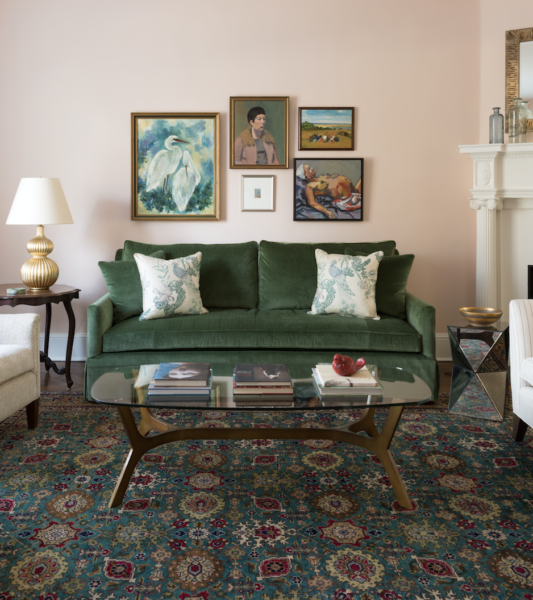Pink and green living room with Oriental rug